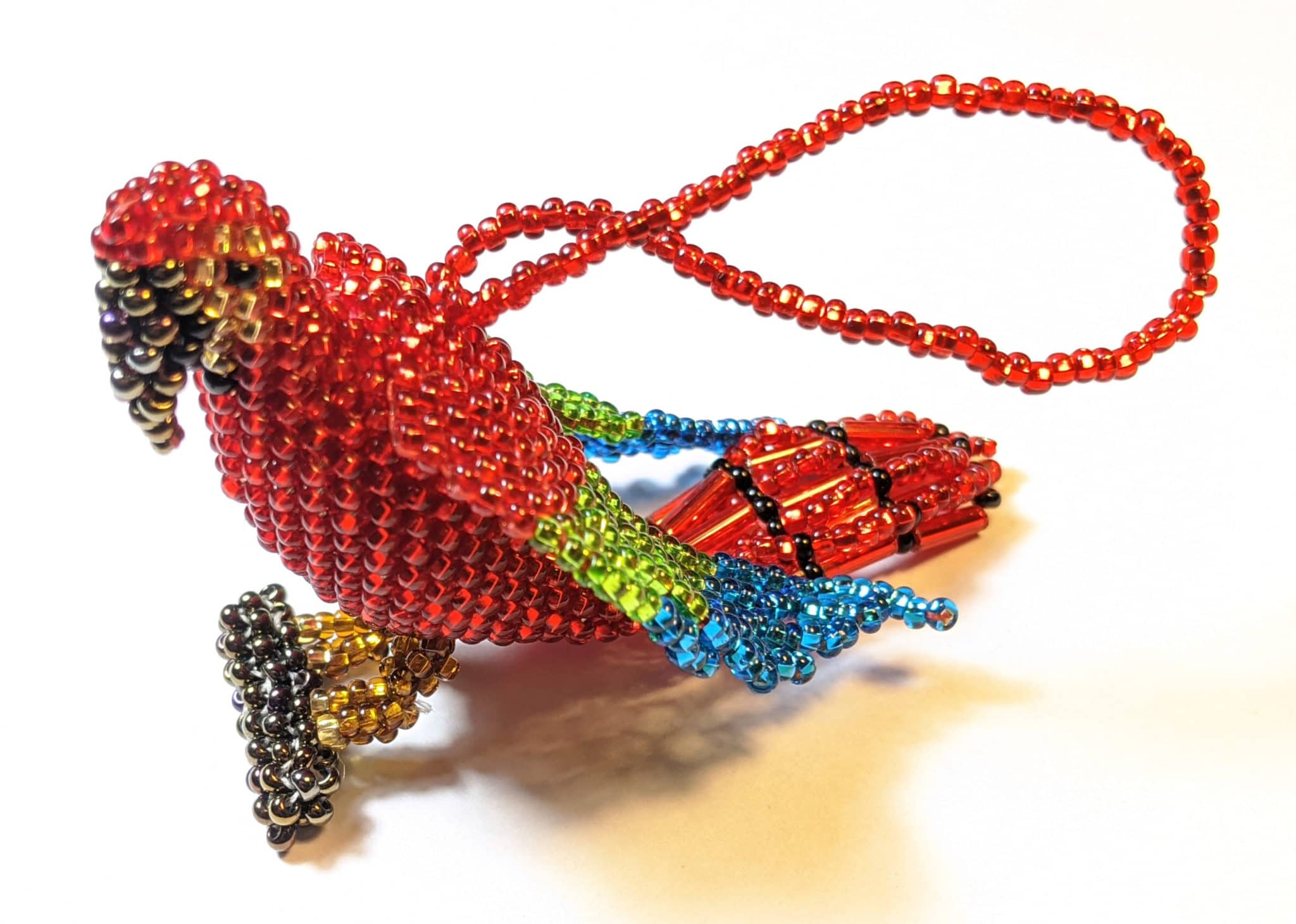 Red Parrot on a Branch Beaded Ornament