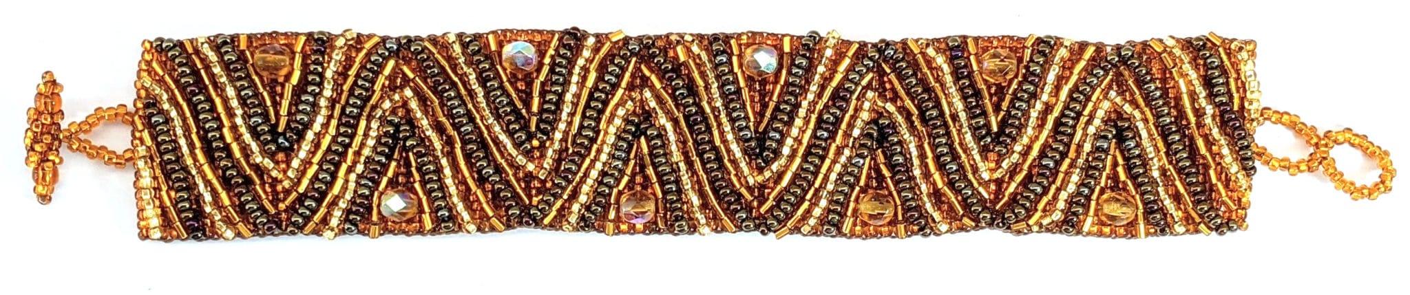 Volcanos and Stars Beaded Bracelet - Golds